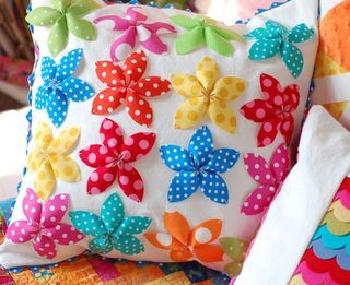 pillow ... love this, definitely going to attempt this with the home-made five petal flowers ... maybe all in christmas fabric's would be cool!