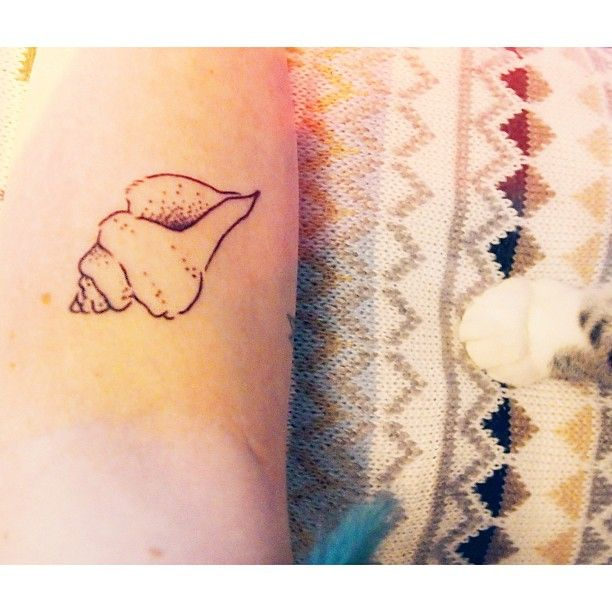 Shell Tattoo in white to look like a birthmark of a mermaid as proof that I was once a mermaid in a previous life. lol