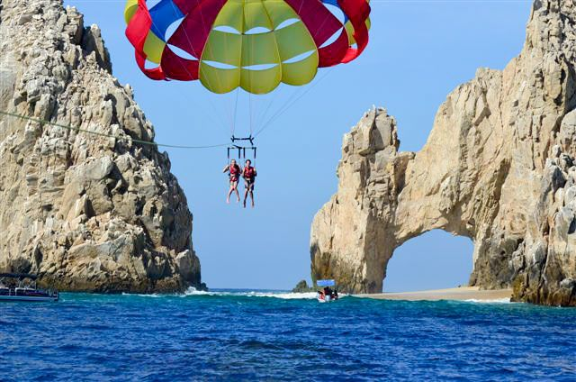 "Parasailing in Cabo San Lucas #Mexico with the team of Cabo Expeditions. A fantastic way to see the arch (""El Arco"") at Land's End. #travel #activities"