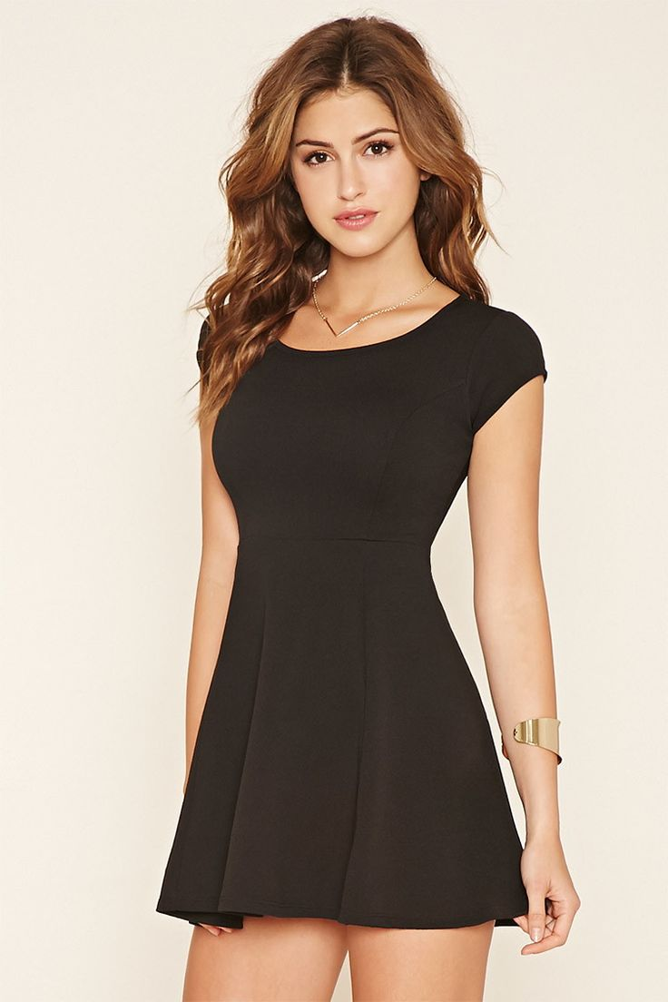 A textured, stretch-knit skater dress featuring a shallow scoop neckline and short sleeves.