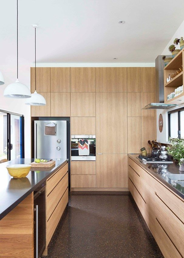 The kitchen has plenty of storage, with cupboards running the length of the space | Home Beautiful Magazine Australia