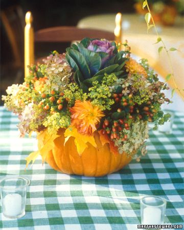 Fall Centerpiece.  Hollow pumpkin, place container inside with floral foam, add water and decorations.