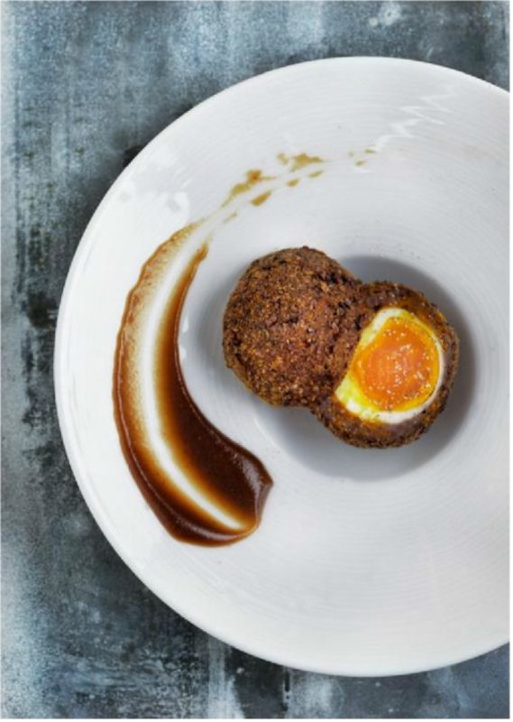 SMOKED VENISON SCOTCH EGG WITH ESPRESSO BROWN SAUCE recipe by professional chef Phil Howard, Elystan Street