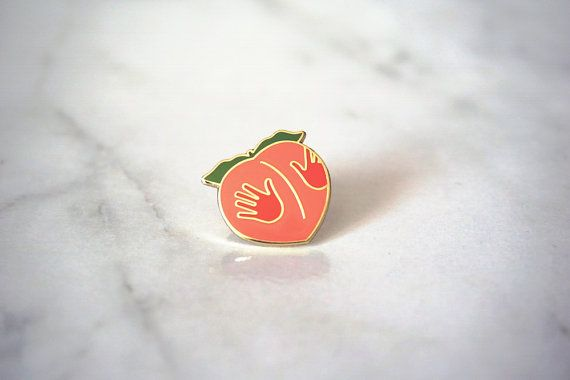 Embrace the true meaning of the peach emoji with our new pin. As avid social media users, we know certain emojis have earned themselves pop culture recognition beyond their basic meanings. Whether it's the eggplant, moon, water drops, or snake, we've all used these icons to express ourselves in creative ways. Our most beloved is perhaps the peach, which is often affectionately used to talk about butts. To honor one of our favorite emojis of all time, we've decided to secure the peach its…