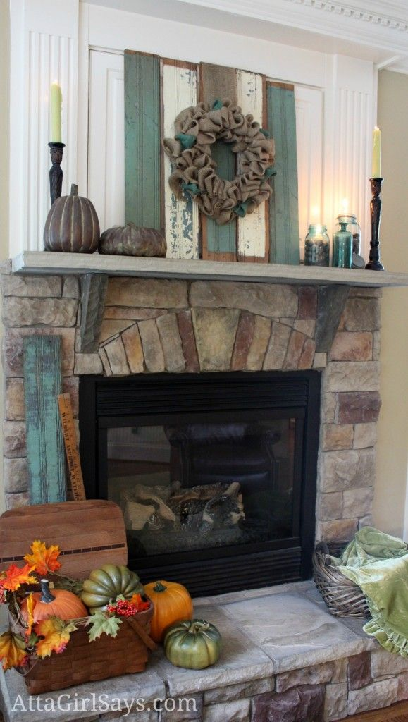 Check out the picnic basket on the hearth . . . . . Rustic chippy wood fall mantel in aqua blue by AttaGirlSays.com