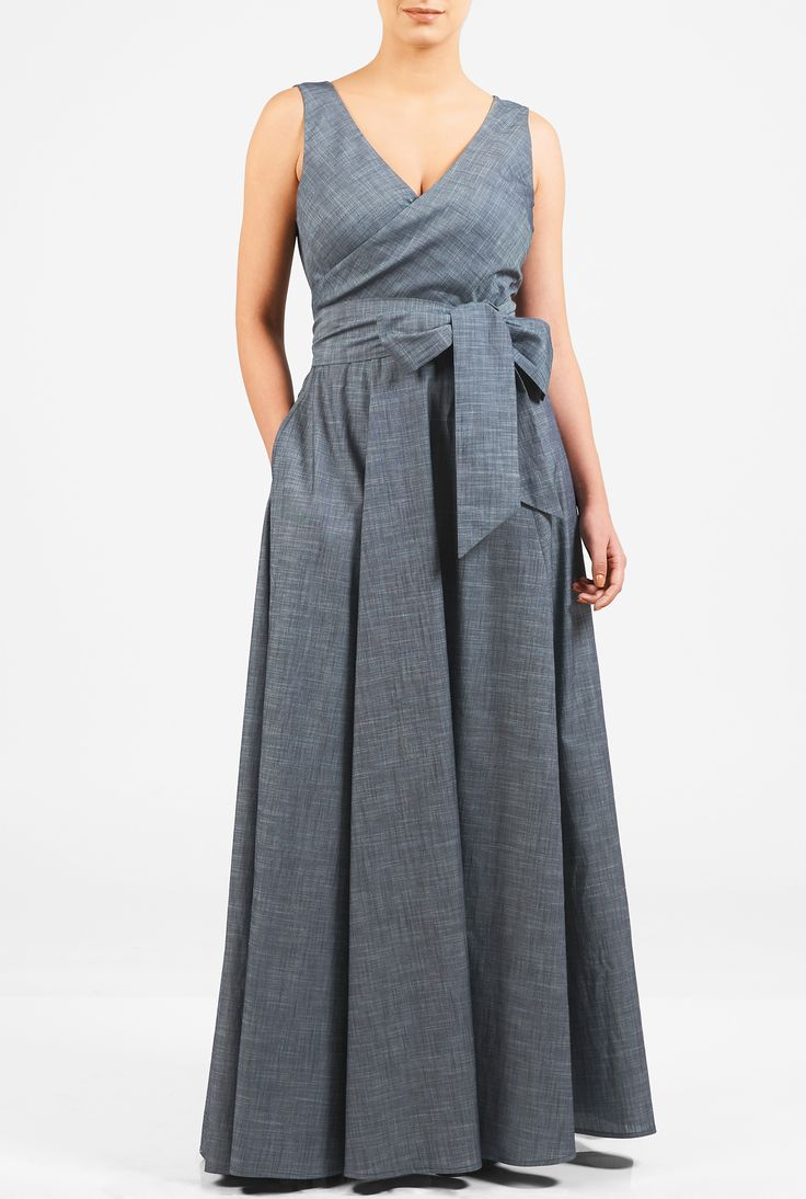 A wide V-neck lends alluring sophistication to our cotton chambray maxi dress with a full flare skirt and a sash tie belt at the wide banded empire waist.