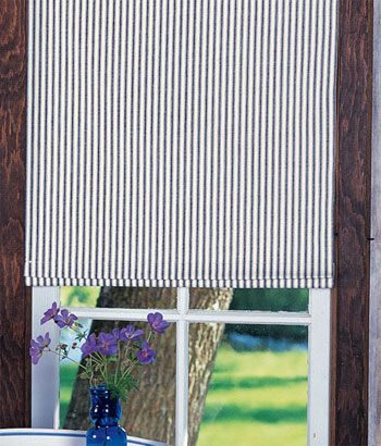 Insulated Ticking Stripes Clutch Roller Shade.  Possibility for upstairs guest room.  Could pair with curtains,