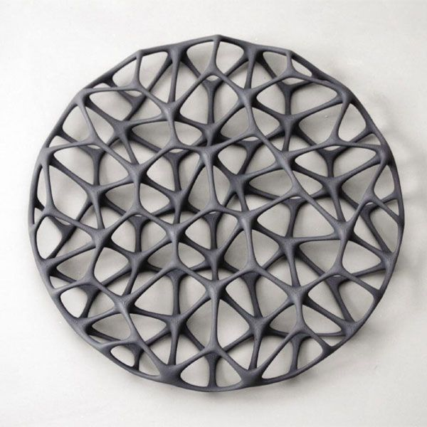 Trabecula: Tray Grey / White Material Laser Sintered Polyamide Designer Janne Kyttanen 2007 Product description This tray was inspired by the inner side and low density part of a bird bone.