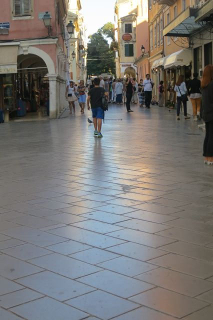 The marble streets of Corfu, Greece are beautiful. Reminds me of Malaga, Spain.