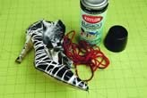 use krylon fusion for plastics, shoes stuffed with newspaper and wrapped in yarn to create your own design.