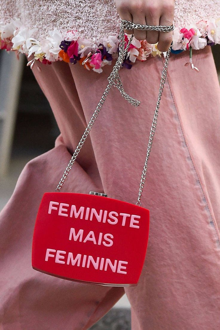 Karl Lagerfeld sends a feminist message down the runway at #PFW with this strap bag. See the look and more, here: