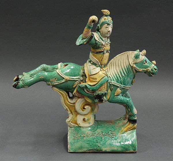 """Chinese Ceramic Roof Tile, Warrior/Horse. Chinese glazed ceramic roof tile, of a warrior on horseback heightened in yellow and green glaze, the base incised with the name of the warrior 'Yang Xi Chiquan Hou', 15""""w;"""