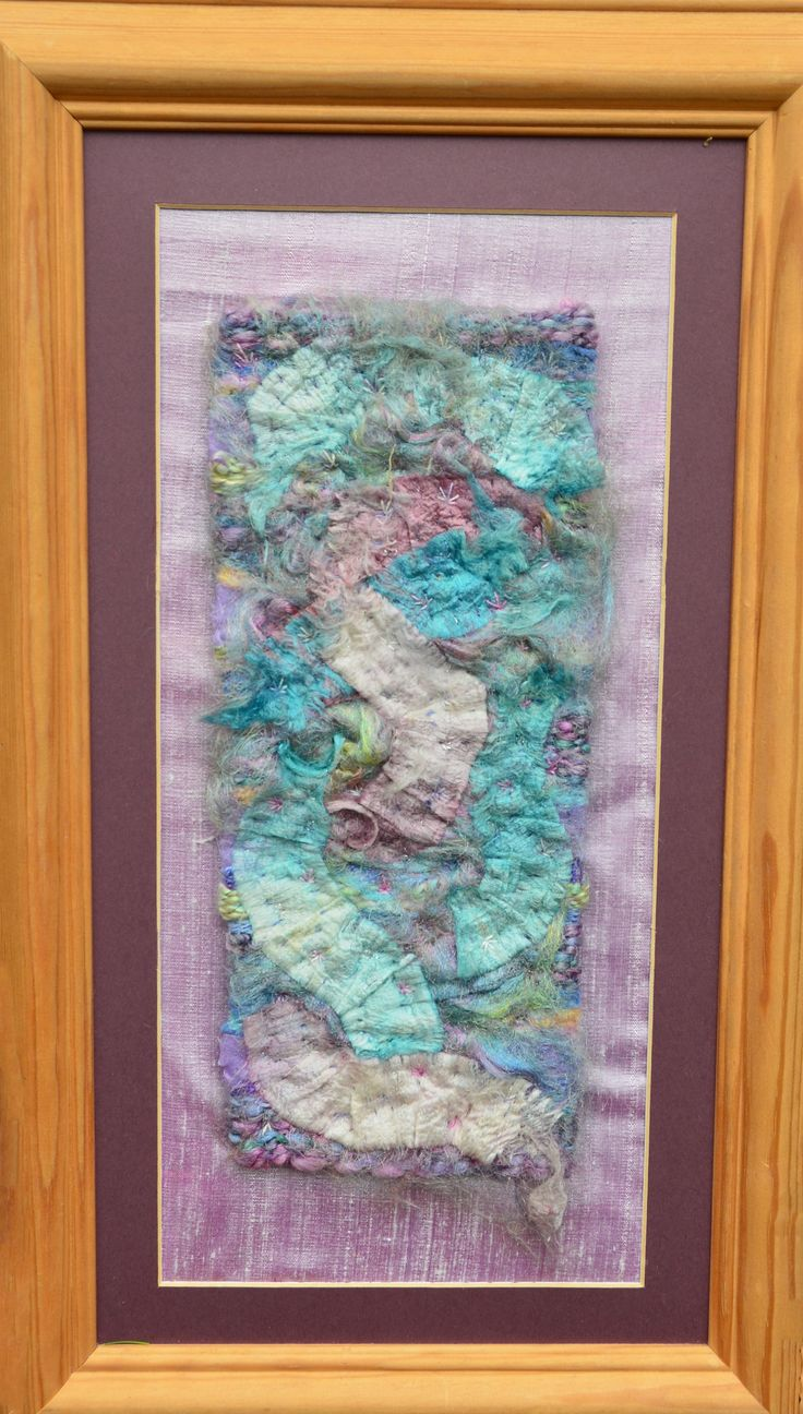 Cocooned, Waves of Grace by Debby Anya Spiby. Hand stitched silk rods on a hand woven background.