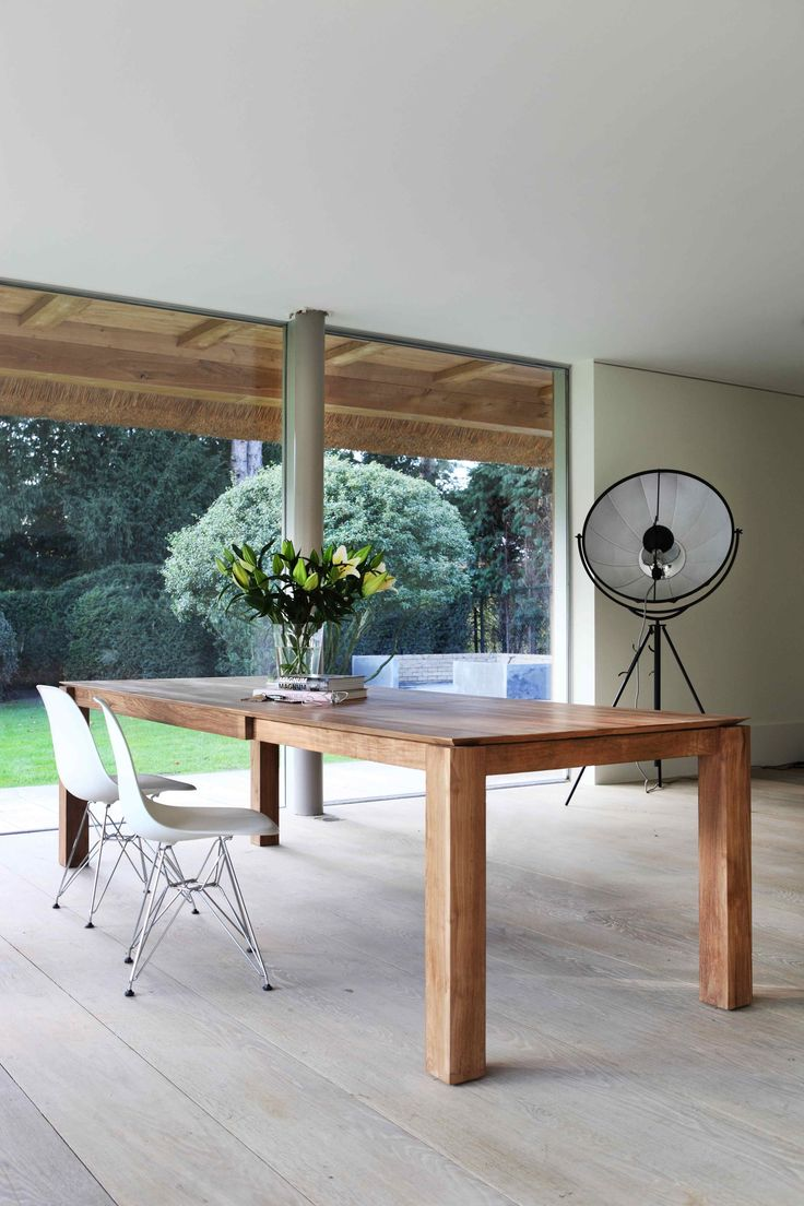 Beautifully crafted Slice Extendable Dining Table by Ethnicraft.