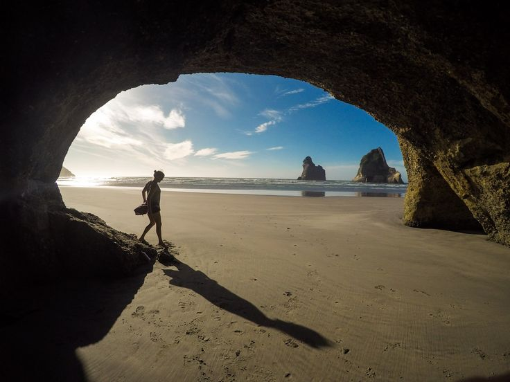 I used timelapse mode on my GoPro to get this shot at New Zealand's Wharariki Beach // Learn my favorite GoPro tips and tricks to improve your travel photography.