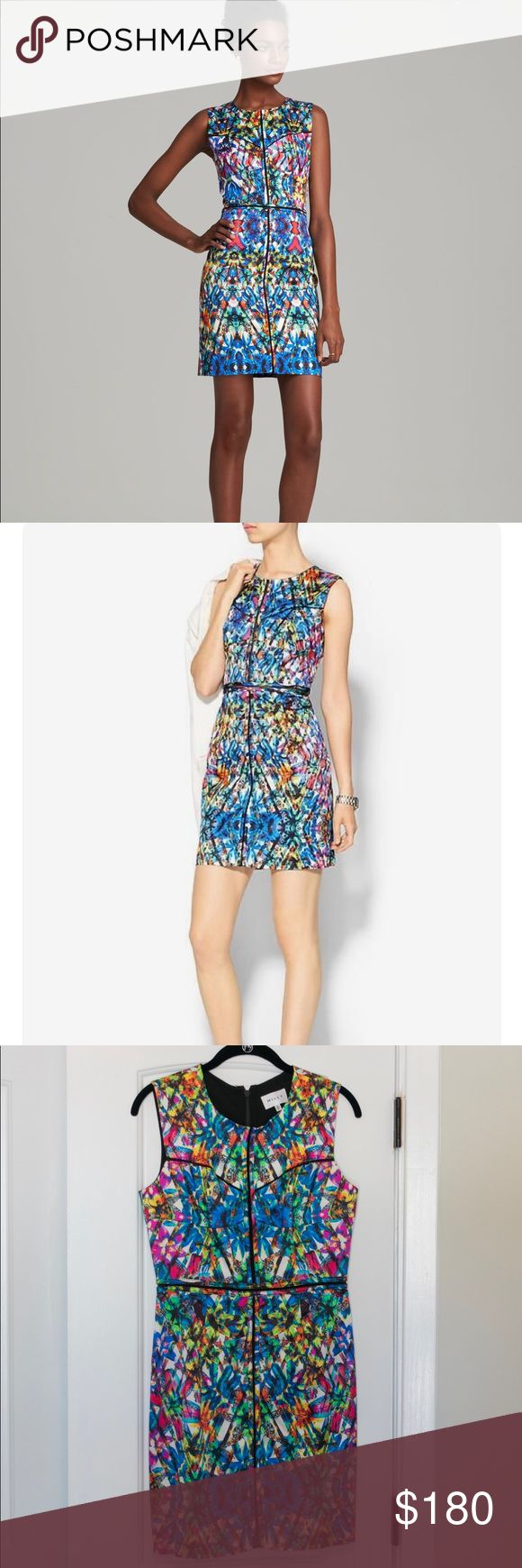 Milly Tropical Floral Dress - Size 6 Whoa is this a stunner! It has a sheer detailed portion through the center seam on top and around the waist. Perfect for a hot night out or vacation! Worn only once for a wedding. Milly Dresses Mini