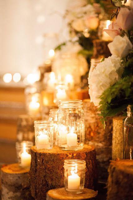 Stunning and elegant January winter barn wedding close to Salem, Oregon. Tree stump and candle ceremony decor