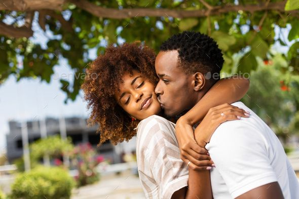 Outdoor Protrait Of Black African American Couple Kissing Each O