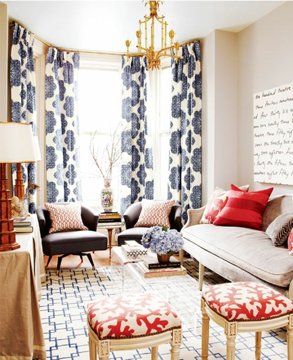 navy and red living room.   I love the mixing of patterns here! I'm looking for a beige couch and blue chairs so this color palate could be a good start
