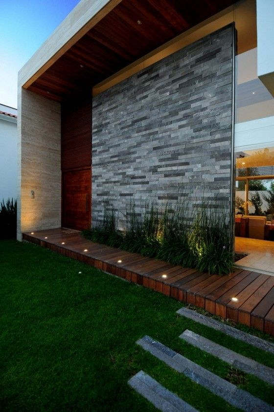 A mini wood deck but with a great stone feature wall!