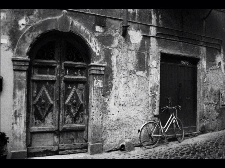 Rome, Italy. An old door and a bicycle.