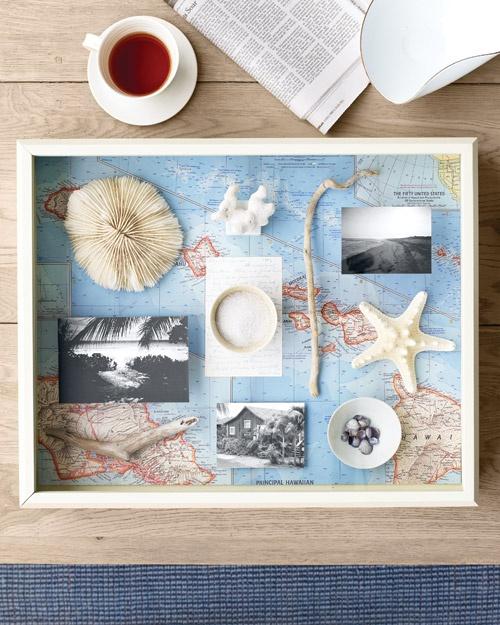 shadow box flat on coffee table with honeymoon stuff/wedding stuff
