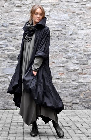 From the Witches' 2013 Lookbook by Yos comes this ensemble, both modern enough to not stand out among Muggles and not so nontraditional as to be unacceptable among wizardkind. The robes also features the thick cowl-neck trending among urban witches this season.