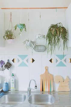 Really liking the rod over cabinets for hanging plants. Kitchen?   Temporary Decorating Ideas Every Renter Should Know - Apartment Therapy