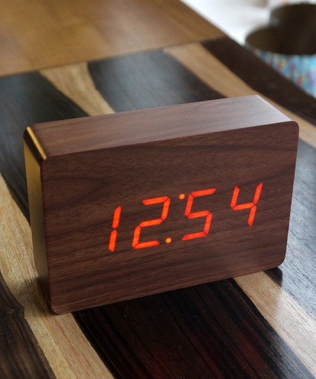 LED Walnut Wood Alarm Clock // These wooden clocks only show the time when you tap the top or snap your fingers. Otherwise they serve as an art piece for a minimalist or natural decor. Switch between temperature, date or time.