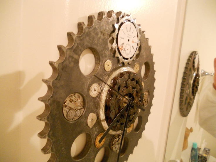 Clock 1 Pic 3. I used a new clock movement...everything else upcycled. Up-cycled components include: motorcycle sprocket, bike chain, watch faces, watch movements, and more...  see Daves Bike Art Stuff on Facebook for more info. or http://davesbikeartstuff.yolasite.com