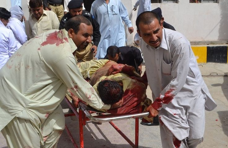 Incredibly Powerful Images Of Eid Al-Fitr 2013, And What They Say About The World Today..Quetta, Pakistan...Pakistani policemen carry an injured colleague into a hospital in Quetta following a suicide bomb attack during a police officer's funeral on the eve of Eid al-Fitr.