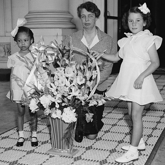 Forgotten Tradition: May Basket Day, May 1. First lady Eleanor Roosevelt receives a May basket of flowers from young children in 1938.