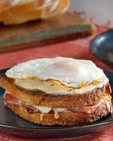 Croque Madame  The croque monsieur -- a grilled ham and Gruyere sandwich topped with rich cheese sauce -- becomes a croque madame when you add a fried egg. These knife-and-fork sandwiches will hit the spot on a cold day. This classic ham sandwich from France is drizzled with bechamel sauce and topped with fried eggs.