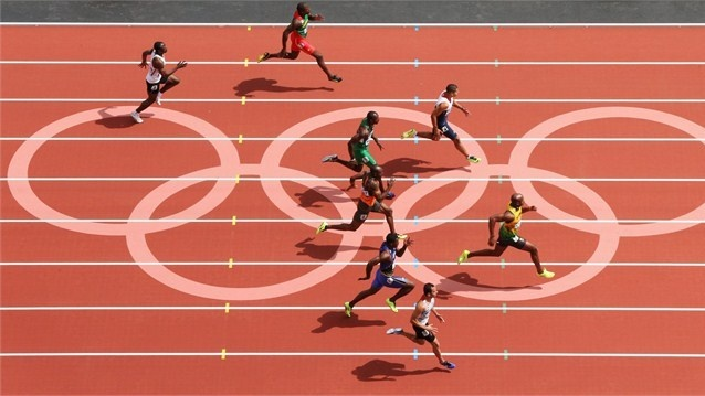 Adam Gemili of Great Britain (lane 4) and Asafa Powell of Jamaica compete in the men's 100m Round 1 Heats at the London 2012 Olympic Games.
