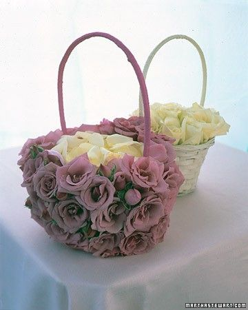 This basket of pink roses makes the flower girl's job easy and pretty.