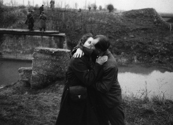 Kisses happen in the midst of gun fires. This image was taken by Mario De Biasi in '56 during Budapest revolution: two hungarian refuges kiss each other passed the border of their country invaded by Soviet.