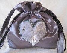 Lovely grey satin bag with fur heart design.