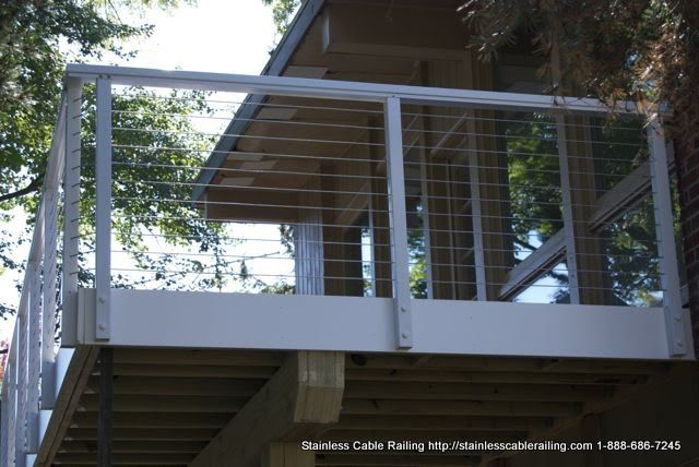 Awesome white deck railing system by Stainless Cable Railing