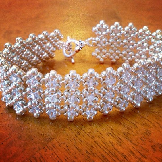 I wove this striking, elegant crystal bridal cuff bracelet from glass seed beads and Swarovski crystals, and finished it with a silver toggle