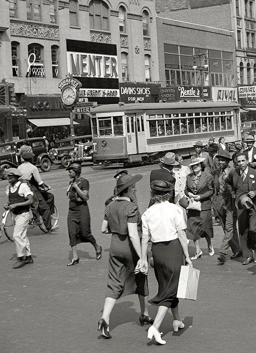 Summer 1938. New York street scene, Seventh Avenue at West 125th.