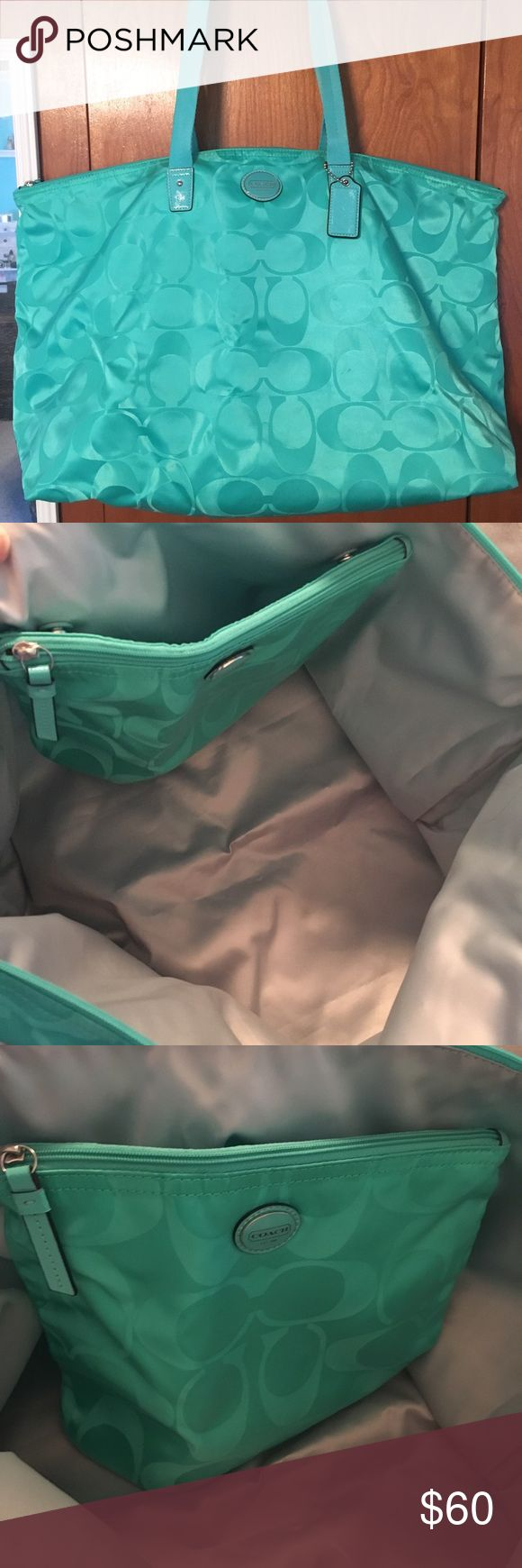 Coach tote bag. Large Coach tote bag, great condition, never used, no damage. Beautiful Seafoam green color. The pouch snaps to the inside of the tote. Tote has silver lining. Coach Bags Totes