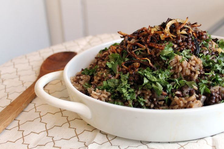 Mujadara is my bowl of lentils and rice: punctuated with Indian spices, laced throughout with bright green herbs and topped with glistening, browned onions.
