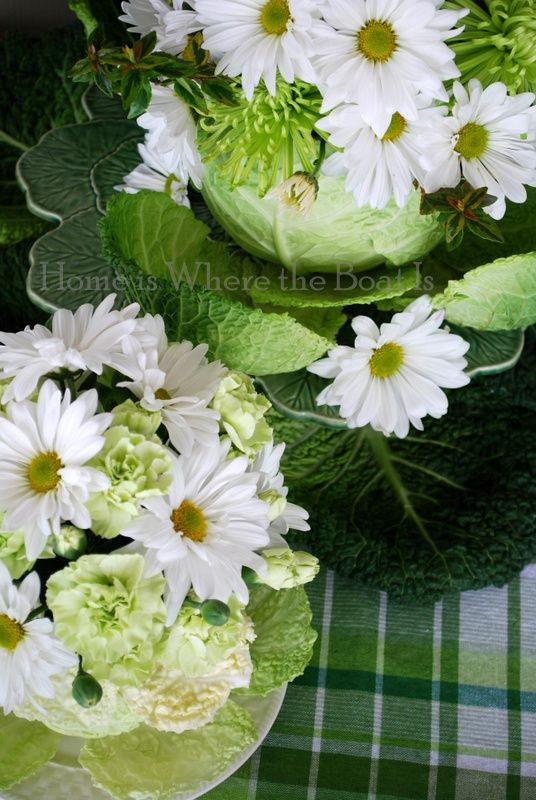Cabbage vases of flower for the Wearing of the Green St. Patrick's Day tablescape | homeiswheretheboatis.net