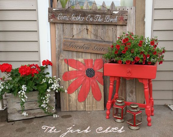 My favorite reds!! Repurposed old fence boards~flowers~and old drawer on an old table base! www.facebook.com/thejunkchick