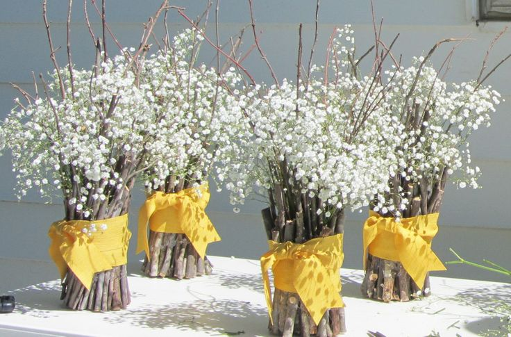 DIY..Hot glue twig bundles, wrap with ribbon, & tuck in baby's breath...inexpensive centerpieces...