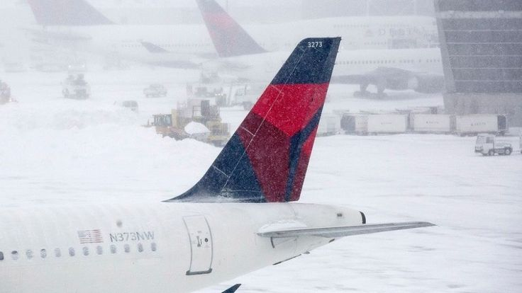 A Delta flight was reportedly delayed for 12 hours -- then cancelled -- due to inclement weather on Tuesday, and passengers are furious.