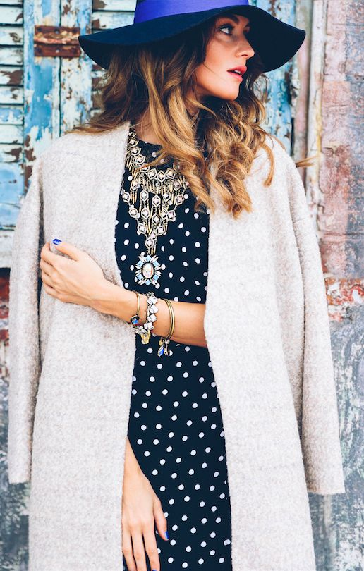 blue hat, neutral coat and statement necklace