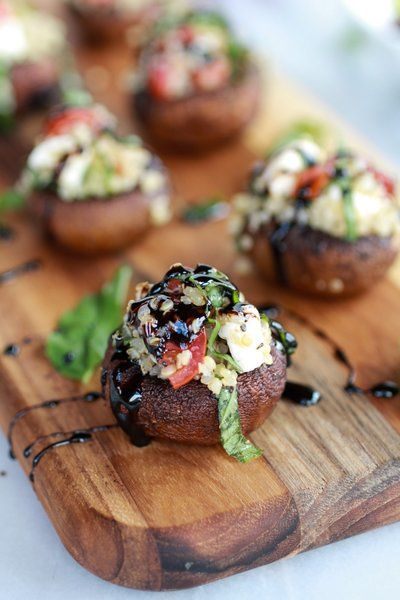 Recipe for Caprese Quinoa Grilled Stuffed Mushrooms with Balsamic Glaze - This is my very first stuffed mushroom and I am now hooked. Watch out mushrooms, I am coming for you!