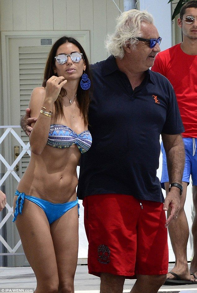 Flavio Briatore Wisely Covers Up While His Wife Struts Her