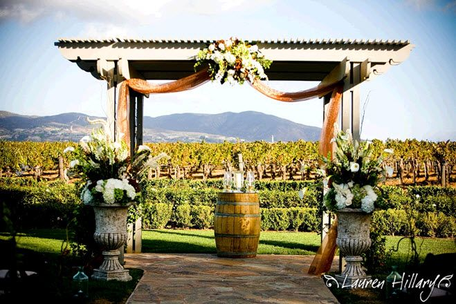 fall wedding trellace ideas | -wedding-ceremony-at-winery-mountains-in-background-wedding-arbor ...